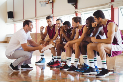 coach talking to his basketball team