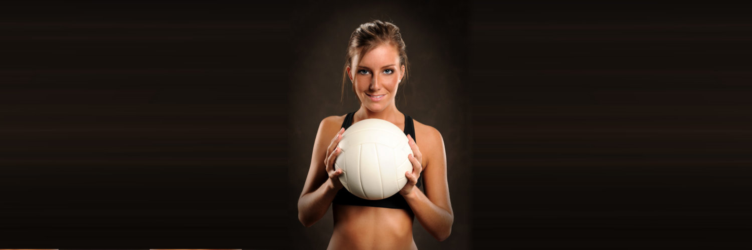 woman holding volleyball player